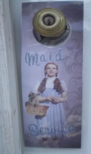 Simmer Motel Maid Service sign for Wizard of Oz suite