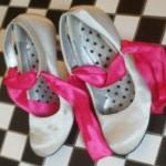 Shoes w/ vivid pink ribbon
